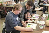 Instructor Aaron Johnson demonstrating technique in the Watercolor class.