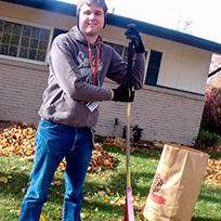 SALN members fundraising in 2013 by raking leaves.