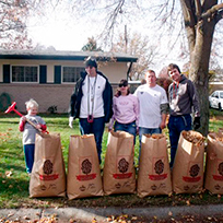 SALN members fundraising by raking leaves.