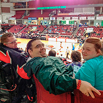 SALN members in attendance at a basketball game in 2014.