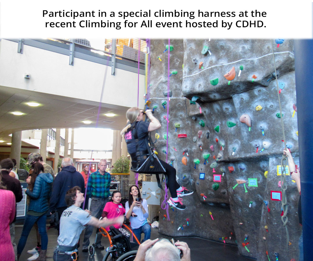 Participant in a special climbing harness at the recent Climbing for All event hosted by CDHD.